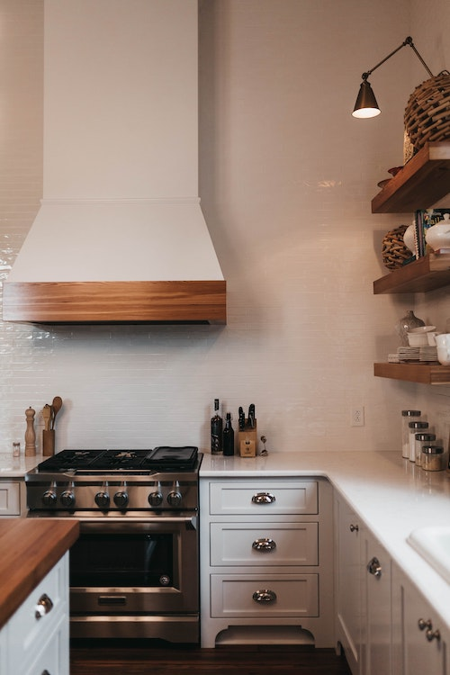 decluttered white kitchen with stove