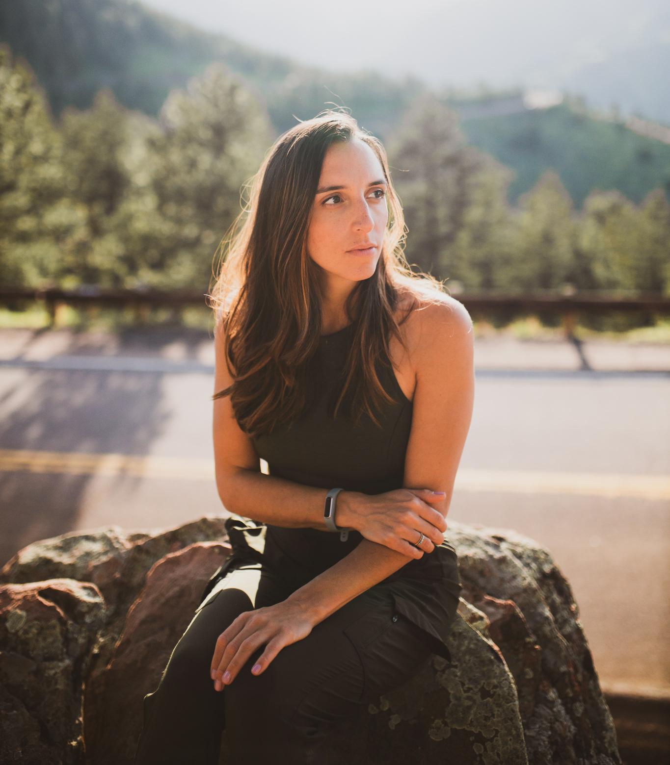 Woman sitting on a rock thinking